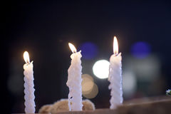 White candlesticks with blur bokeh background. image for background. Wallpaper and copy space. rest in peace concept. romantic dinner for aniversary concept Stock Photos