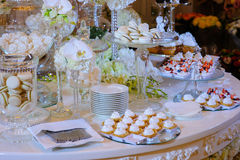 White candy bar at a wedding. With pretty flowers royalty free stock photography