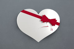 White candy box in a heart shape Royalty Free Stock Images