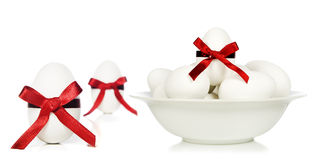 White candy easter eggs with red ribbons Stock Photos