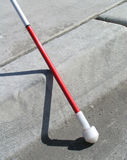 White Cane. Touching street curb Stock Photography