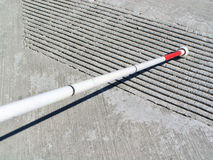 White Cane. Touching ridges on a curb Royalty Free Stock Image