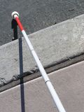 White Cane. Touching street curb Royalty Free Stock Images