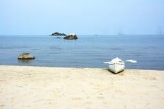 White Canoe on the Beach. Lake Malawi, Malawi, Africa stock image