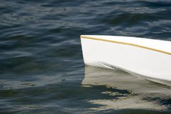 White canoe, kajak and rowing on lake water.  stock image