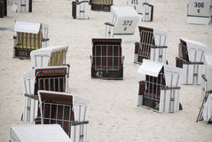 White canopied beach chairs at Baltic Sea. Lots of white canopied beach chairs at Baltic Sea Stock Images