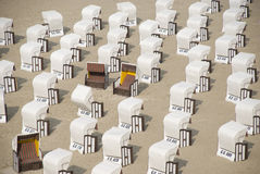 White canopied beach chairs at Baltic Sea. Lots of white canopied beach chairs at Baltic Sea Stock Photography