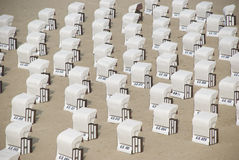 White canopied beach chairs at Baltic Sea Stock Photography