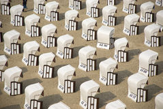 White canopied beach chairs at Baltic Sea Stock Photo