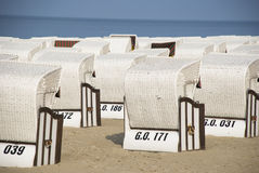 White canopied beach chairs at Baltic Sea. Lots of white canopied beach chairs at Baltic Sea Royalty Free Stock Images