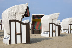 White canopied beach chairs at Baltic Sea Royalty Free Stock Image