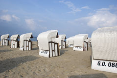 White canopied beach chairs at Baltic Sea. Lots of white canopied beach chairs at Baltic Sea Royalty Free Stock Photography