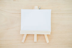 White canvas art board on wood texture background Stock Photography