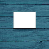 White canvas frame on a  blue wooden background. Stock Images