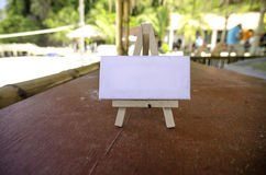 White canvas frame and wooden tripod under bamboo hut. Royalty Free Stock Photo