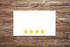White canvas in front of brown wall four stars Royalty Free Stock Images
