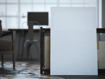 White canvas near the table in loft interior. 3d rendering Stock Images
