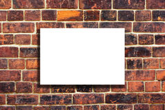White canvas on an old brick wall Stock Image
