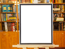 White canvas of picture frame on easel in library Stock Images