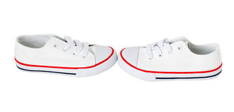 White canvas shoes with red strip. Royalty Free Stock Photo