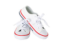 White canvas shoes with red strip. Royalty Free Stock Image