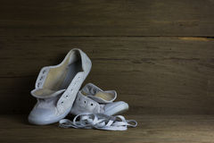 White canvas shoes on wood background, still life Stock Photography