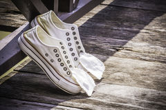 White canvas shoes, youth culture and style. Royalty Free Stock Photos