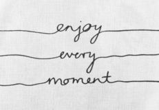 White canvas texture with text enjoy every moment life quotes. White canvas texture with text positive quote enjoy every moment in your life quotes royalty free stock photography