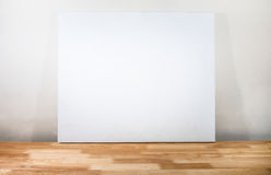White canvas. On wooden desk Stock Image