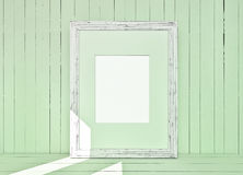 White canvas on wooden plank green background Stock Image