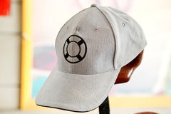 White cap with lifebuoy symbol on front Stock Photo