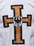 White cape with Teutonic cross. Closeup of white cape with Teutonic cross royalty free stock photos