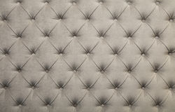 White capitone tufted fabric upholstery texture. White beige velvet capitone textile background, retro Chesterfield style checkered soft tufted fabric furniture Royalty Free Stock Photos