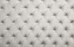 White capitone tufted fabric upholstery texture Royalty Free Stock Photos