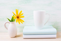 White cappuccino mug mockup with yellow rosinweed flowers in pit Stock Photos
