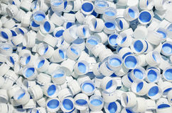 White caps of plastic bottles Royalty Free Stock Photography