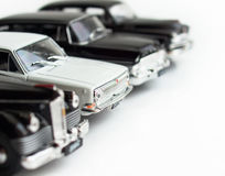 White car. Amongst black. Retro cars Stock Photo