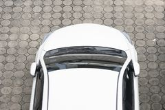White car aerial view of parking lane. White car from above in the parking area of a top view of the house stock photo