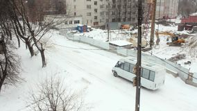 White car on background winter construction stock video footage