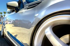 White car with blue strips and white rims closeup shot from the Royalty Free Stock Photography