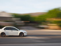 White car with blur Royalty Free Stock Images