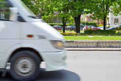 White car. Blurred white car in motion on the city boulevard Stock Photo