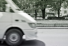 White car. Blurred white car in motion on the city boulevard Stock Image