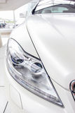 White car. Is a white, bright showroom Royalty Free Stock Images