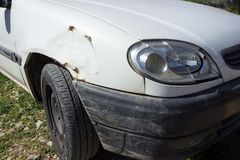 White car with a broken headlight and front wing. Concept - acci. Dent, car insurance, damage assessment and service Stock Image