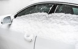 Winter on the road - car covered with snow royalty free stock photos
