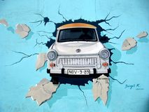 White Car Crash in Blue Wall Signature Painting Royalty Free Stock Images