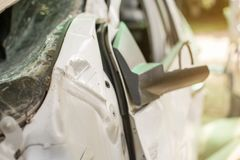 White car damaged automobiles after collision on the road. Close up of white car damaged automobiles after collision on the road stock image