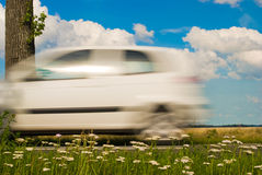 White car driving by Royalty Free Stock Photos