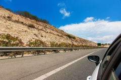 White car driving by autobahn in with motion blur. Car on the road with motion blur background Stock Images